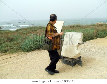 Tourist Reading Instructions About A Stone/Ruin