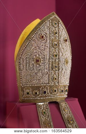 Florence Italy-June 12 2015. Close up view of a Papal Mitre adorned with jewells on display in the Medici Galleries Florence Italy