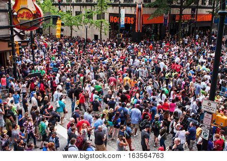 ATLANTA, GA - SEPTEMBER 2016:  A huge crowd of spectators disperses on Peachtree Street following the conclusion of the annual Dragon Con parade in downtown Atlanta in Atlanta GA on September 3 2016.