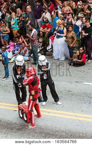 ATLANTA, GA - SEPTEMBER 2016:  People wearing Adidas sweatsuits pose as hip hop storm troopers from the Star Wars movies while participating in the annual Dragon Con parade on Peachtree Street in Atlanta GA on September 3 2016.