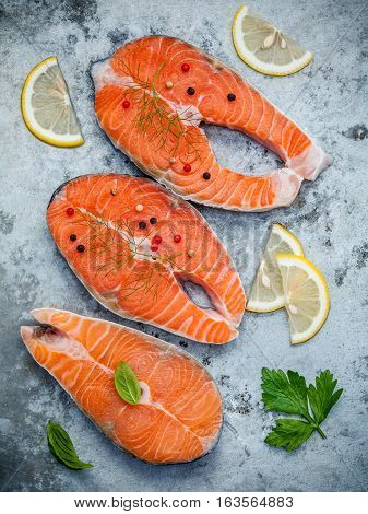 Fresh Salmon Fillet Sliced Flat Lay On Shabby Metal Background. Raw Salmon Fillet And Ingredients Pa