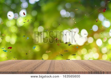 Empty wood table and ribbon motion multicolored light bokeh for Christmas New Year background. with copy space add text