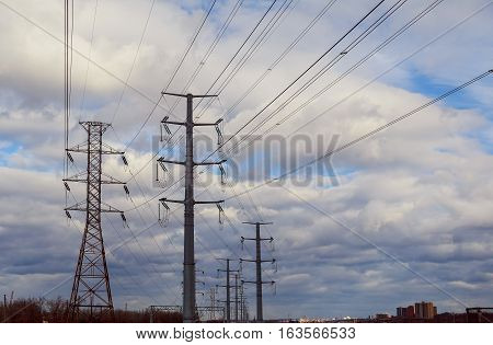 storm clouds sky Electric poles High-voltage power lines against the background of a stormy sky