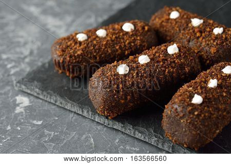 Chocolate cake on a gray background close up
