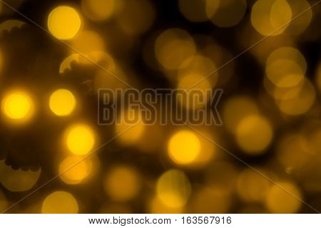 The blur yellow bokeh light background (de-focused)
