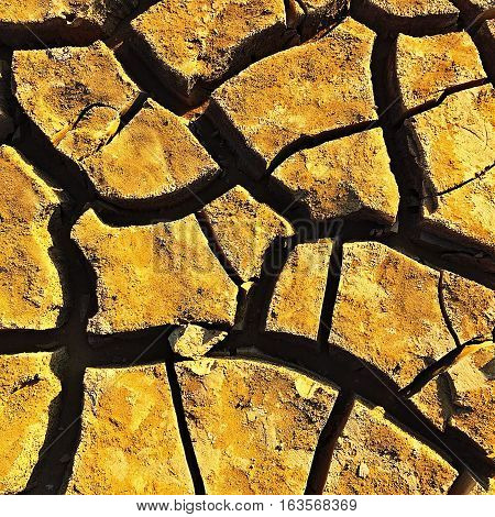 Ground cracked ground gold ground texture nature abstract