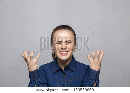 Portrait of stressed woman on gray background