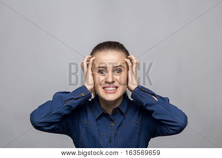 Portrait of yelling woman on gray background