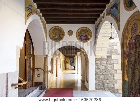 Kykkos Greece - November 24 2016: Cyprus island the sacred paintings and decorations of the Kykkos monastery courtyard porch