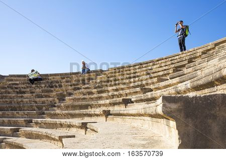Pafos Greece - November 25 2016: Cyprus island archaeological site tourists in the Odeon ruins
