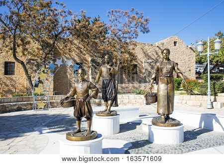Aya Napa Greece - November 26 2016: Cyprus island statues of local people in traditional dress in front of the Monastery