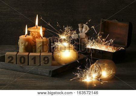2019 written on cubes on wooden background