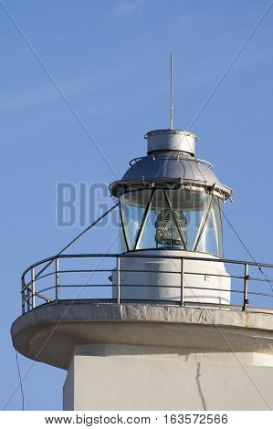 detail of white light house in the harbour of la spezia