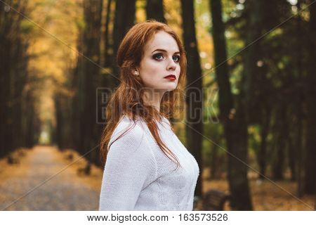 Portrait Of Happy Beautiful Redhaired Girl Smiling