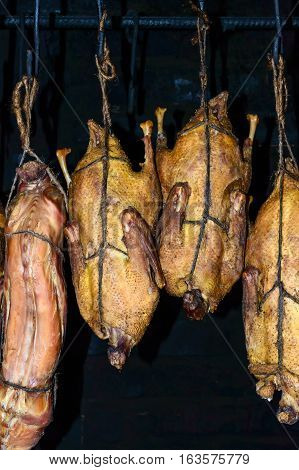 The process of smoked meat (poultry duck rabbit) at home. The carcass suspended in the smokehouse. Traditional way of cooking meat in Europe.