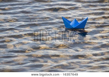 paper ship in water