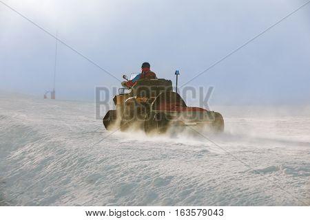 Ski patrol evacuate an injured skier on in winter