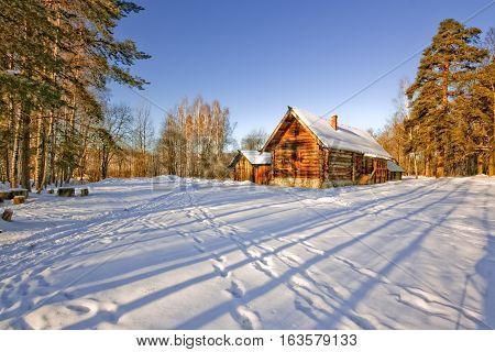Winter landscape with the rural house in the morning