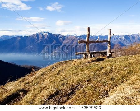 Gambarogno Switzerland: Trail of Mount Gambarogno and views of the mountains and Lake Maggiore. bench craft with lake view