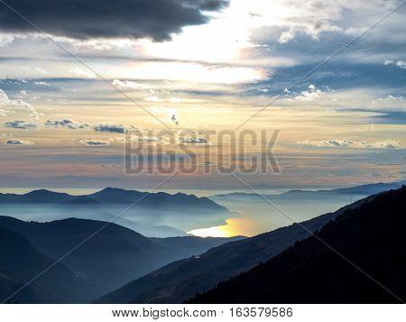 Gambarogno Switzerland: Trail of Mount Gambarogno and views of the mountains and Lake Maggiore. sunset over the lake maggiore