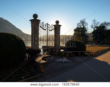Lugano Switzerland. Old gate for access to the lake of the park Ciani oldest botanical garden. The park is famous and visited by many tourists every year.