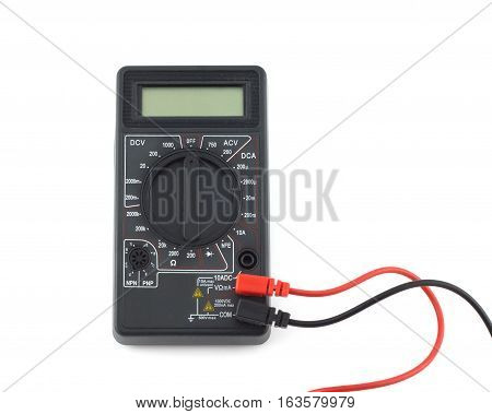 Turned off digital multimeter with blank display with black and red wires lies isolated on white background closeup