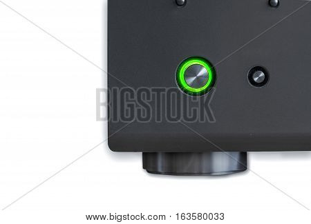 Corner AV receiver with the green power  button on a white background