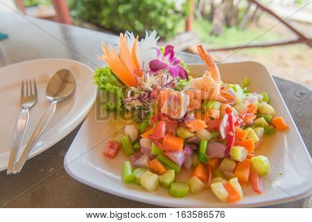 spicy shrimp and mix vegetable salad , thai food.