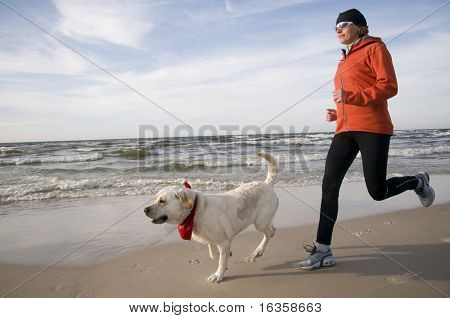 Running with dog on the beach