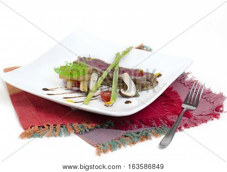 Medium rare Beef steak grilled with barbecue sauce with tomato and French fried. Delicious steak on white plate on over white background.