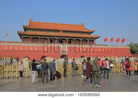 BEIJING CHINA - OCTOBER 26, 2016: Unidentified people visit iconic Tiananmen gate Beijing China
