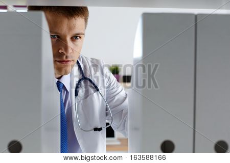 Male Medicine Therapeutist Doctor Standing In Office