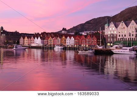 Bergen Norway - October 6 2016: Historic Hanseatic houses on the harbor of Bergen Norway in Scandinavia at sunset