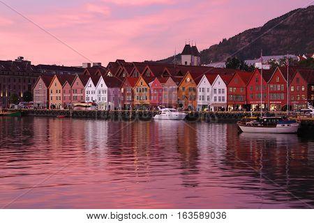 Bergen, Norway - October 10, 2016: Hanseatic houses on the harbor of Bergen, Norway, in Scandinavia with beautiful pink sunset