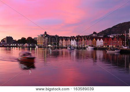 Bergen Norway - October 6 2016: Historic Hanseatic houses on the harbor of Bergen Norway in Scandinavia at sunset