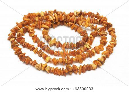 Amber necklace natural and untreated, on a white background