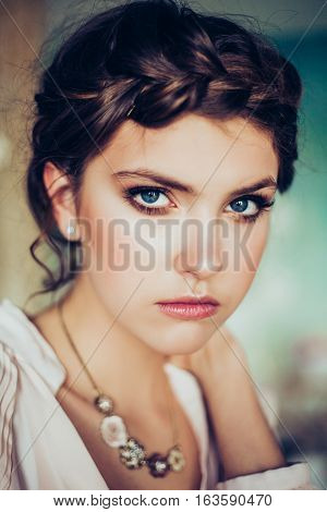 Beautiful young woman. Professional make-up and hairstyle. Perfect skin. Fashion photo.
