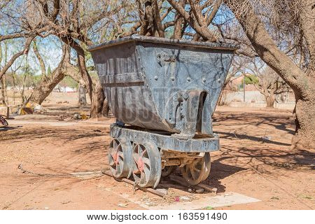 KOFFIEFONTEIN SOUTH AFRICA - DECEMBER 24 2016: An historic mine-cart also called a cocopan in Koffiefontein (coffee fountain) a diamond mining town in the Free State Province