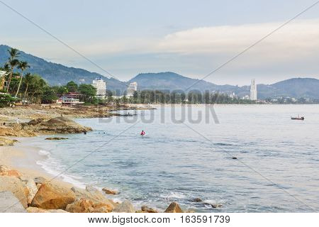 Kalim beach and Patong beach on twilight cloudy day Phuket Thailand. It is well-known destination for tourists all over the world.
