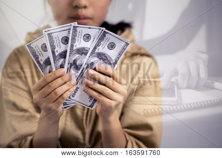 Asian Business Woman Showing Her 100 Dollar Bill With Working Woman Investment For Success And Profi