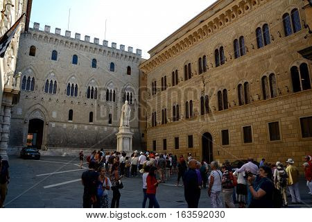 Siena Italy - September 8 2016: Piazza Salimbeni square in Siena city in Tuscany Italy. Unidentified people visible.