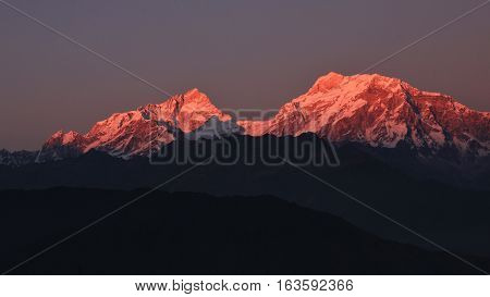 Pink colored peaks of Mt Manaslu and Mt Ngadi Chuli. View from Ghale Gaun.