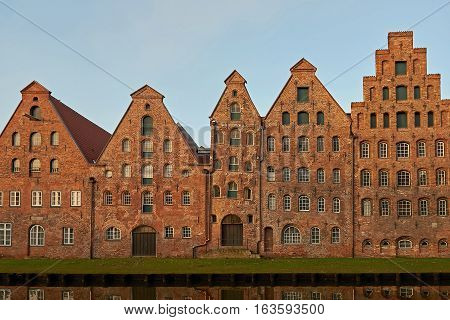 The Salzspeicher of Lübeck Germany in the warm light of sunrise