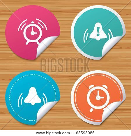 Round stickers or website banners. Alarm clock icons. Wake up bell signs symbols. Exclamation mark. Circle badges with bended corner. Vector