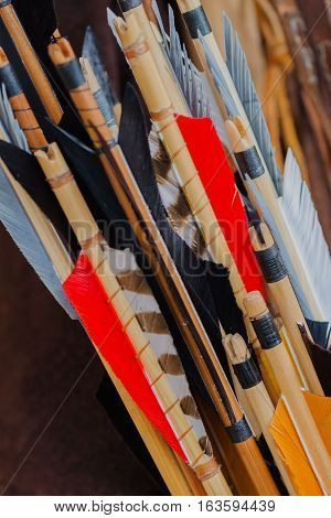 Closeup Historical set of old wooden arrows with bright plumage