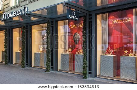 Zurich, Switzerland - 1 January, 2017: windows of the Omega watch store on Bahnhofstrasse street, with Christmas decorations. Omega watches are manufactured by Omega SA, a Swiss luxury watchmaker based in Biel, Switzerland.