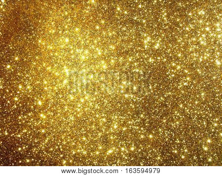 Glittering gold background. Gold glitter texture. Color textured paper for craft and art. Illustration