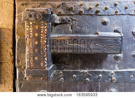 Wooden latch of the wooden ancient gate of the caravansary (Wikala) of Bazaraa Cairo Egypt
