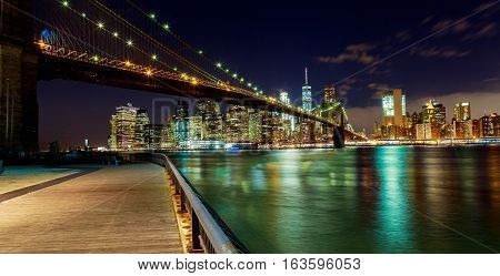 New York City Brooklyn Bridge And Manhattan Skyline Hudson River Illuminated