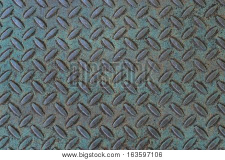 Old weathered treadplate background with blue-green patina